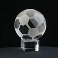 optical crystal soccer ball stand on clear glass base